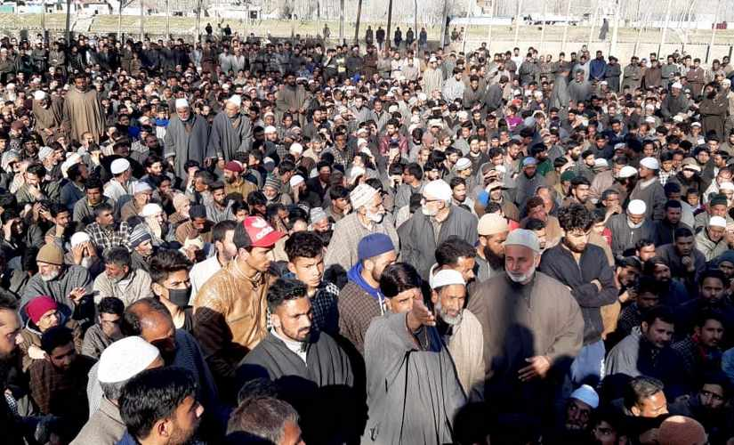 Villagers gather for the funeral of Atif Mir, a 12-year-old who was killed by LeT militants on Thursday. Sameer Yasir