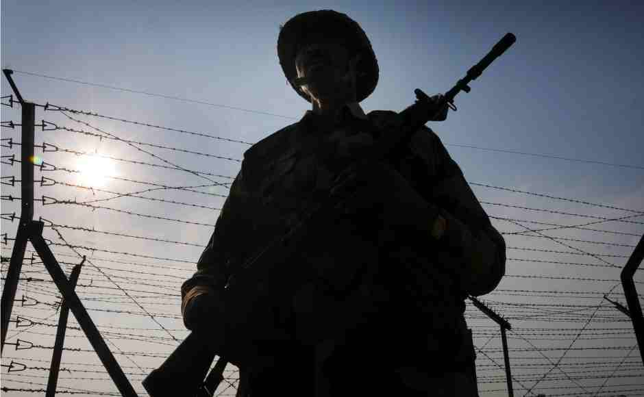 Border Security Force personnel stand guard along the international border at Attari near Amritsar as security beefs up amid escalating tension between India and Pakistan. PTI