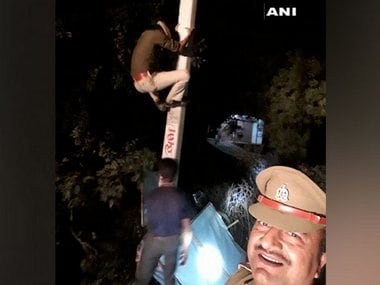 Uttar Pradesh cop clicks selfie while constable climbs electric pole to remove political banner, probe ordered