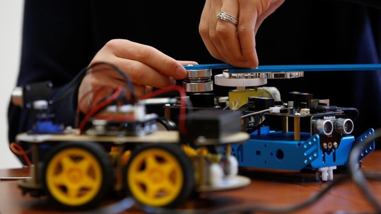 Researcher students working on their artificial intelligence project to train robots to autonomously carry out tasks at the University of Malta in February 2019. Image: UoM