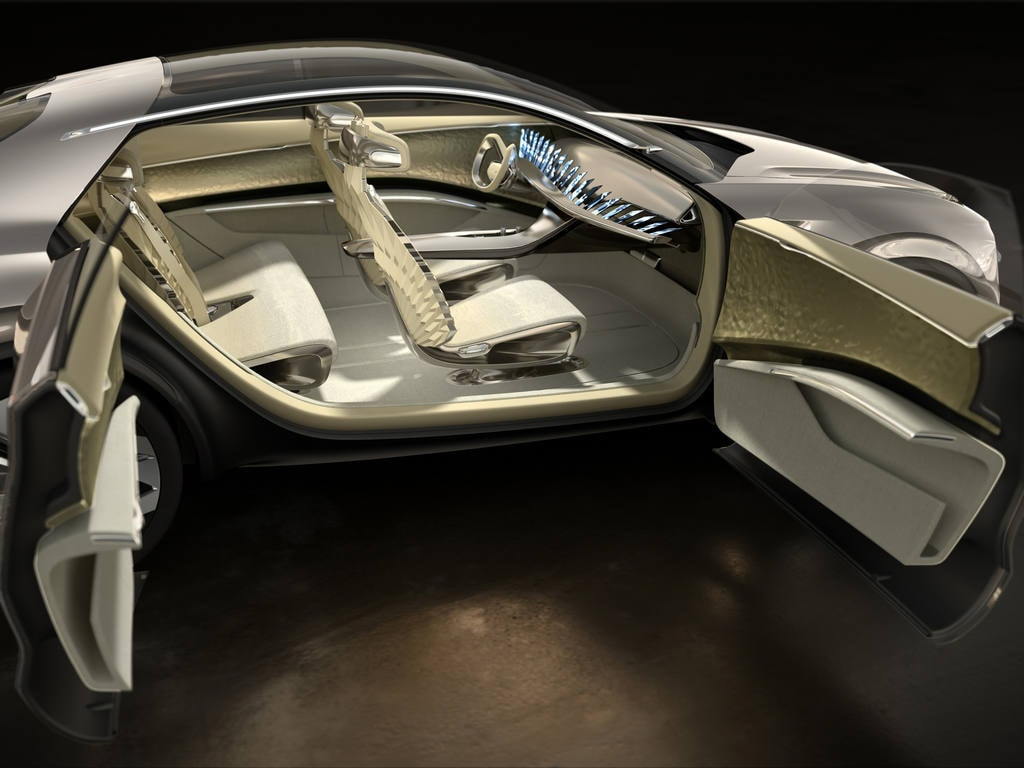 The highlight of the Kia Imagine concept car is an array of 21 smartphone-sized LCDs that form the dashboard. The car's interior features a yoke-style steering wheel.