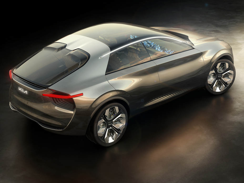 The Kia Imagine EV crossover sports 22-inch alloy wheels that have plexiglass elements. It has a panoramic sunroof that is cut off by a sharp-angled line.
