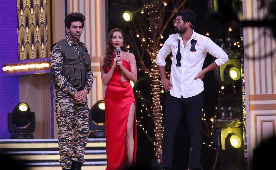 Hosts Kartik Aaryan and Vicky Kaushal with Malaika Arora. Firstpost/Sachin Gokhale