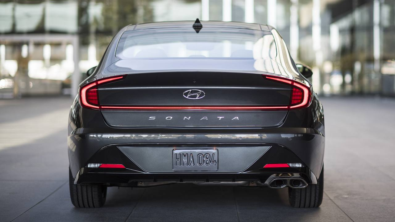 At the rear, a wide horizontal line extends across the center of the trunk, stretching to the edges of the car. This line is actually a long LED strip that connects each brake light.