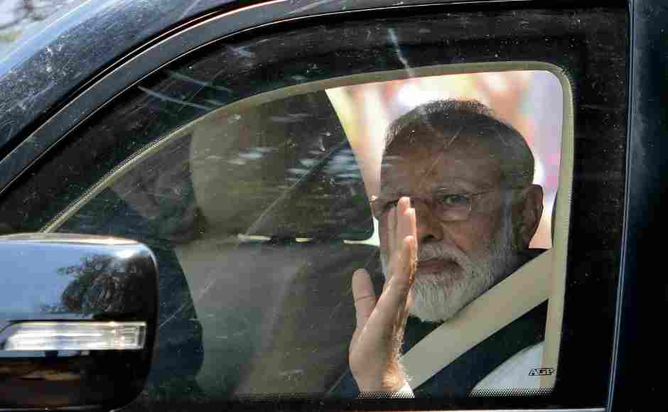 Modi was seen waving as he leaves after filing his nomination papers in Varanasi. Before filing his nomination, he offered prayers at a temple. AFP