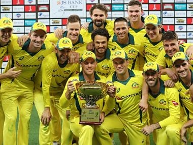 Australian players pose with the trophy after winning the series 5-0 against Pakistan. AFP
