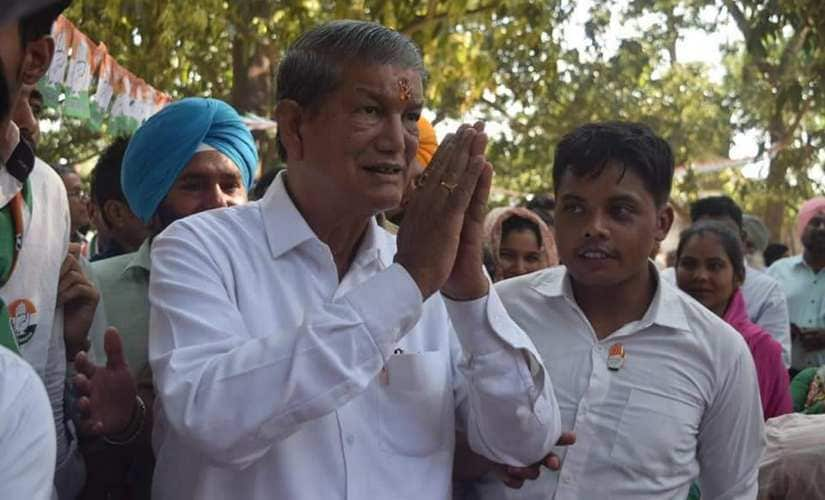 Congress leader Harish Rawat greets supporters after casting his votes. Rahul Singh Shekhawat /101Reporters