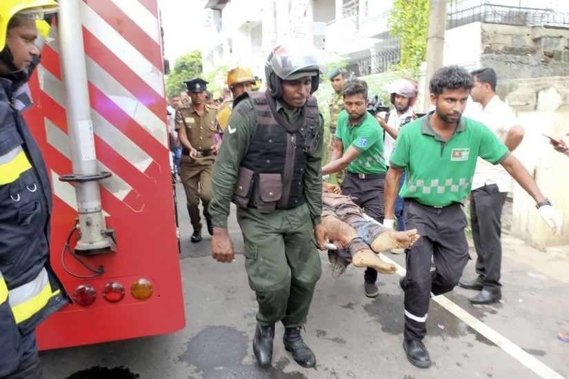 Injured being moved from the site of a blast at Dematagoda, Colombo. A Gamage/101Reporters