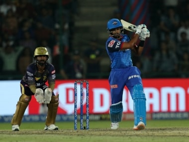 Delhi Capitals' captain Shreyas Iyer (R) in action as Kolka Knight Riders' skipper Dinesh Karthik looks on. Sportzpics