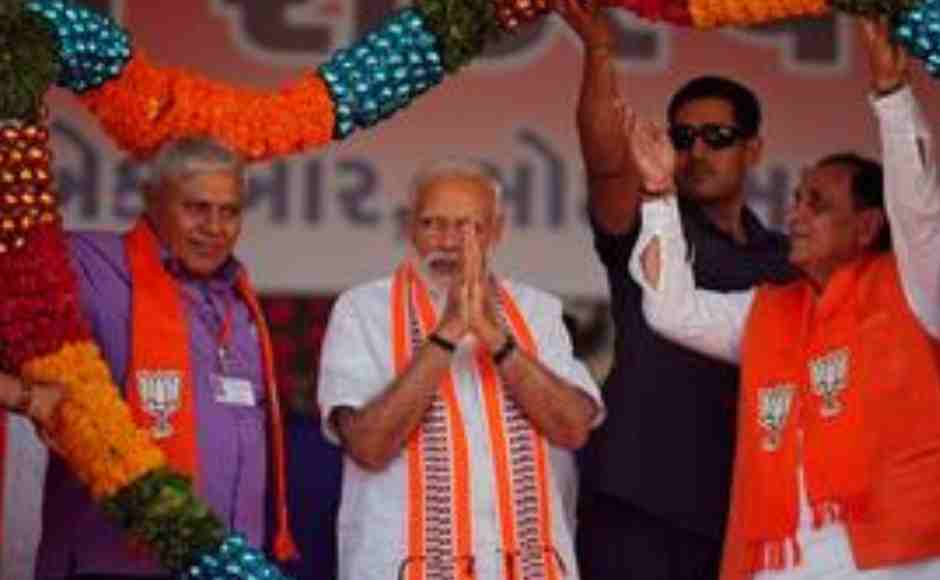 Prime Minister Narendra Modi gestures as he is presented with a garland during an election campaign rally in Junagadh, Gujarat on Wednesday. Reuters