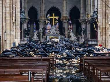 Like a bombing: Daylight reveals extent of Notre-Dame damage as blaze leaves behind piles of rubble, charred debris
