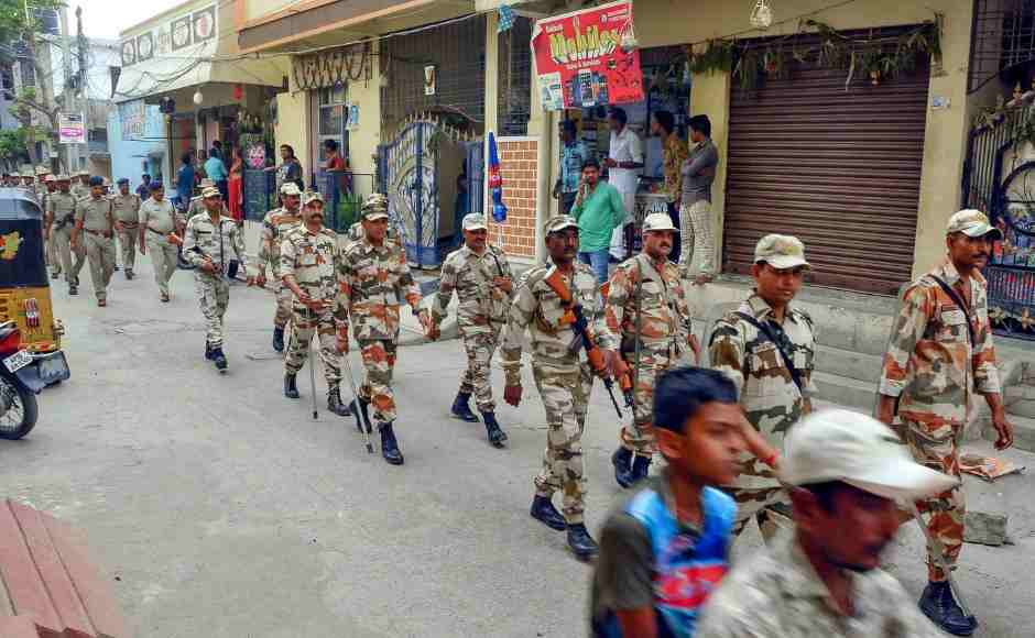 Security forces personnel march in a street at Uppaguda in Hyderabad on Wednesday, a day before phase-I of 2019 Lok Sabha elections. PTI