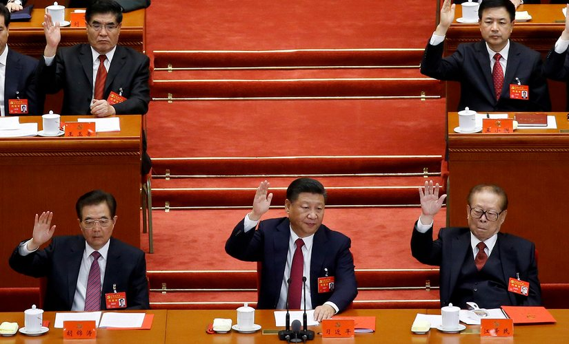 Xi Jinping has abandoned the cautious approach of his predecessors. Here he is seen flanked by former presidents Hu Jintao (left) and Jiang Zemin (right) at the 19th Communist Party Congress in Beijing in October 2017. Reuters