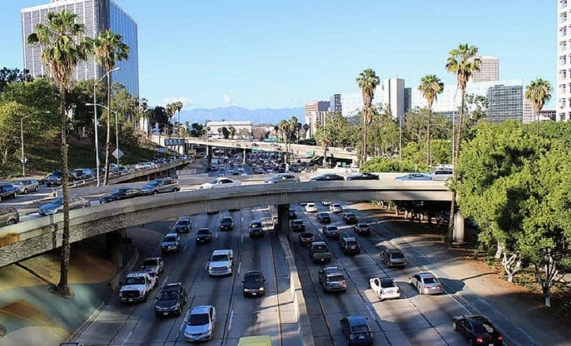 The Harbor Freeway, California State Route 110, in Downtown Los Angeles during afternoon rush hour. Multi-level roads filling up with new traffic. Image courtesy: Wikimedia Commons