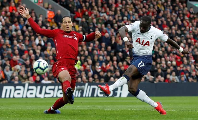 Virgil Van Dijk puts Tottenham's Moussa Sissokho under a bit of pressure. Reuters