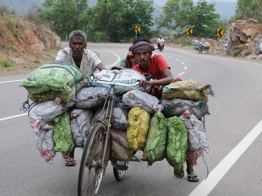 Labourers often carry coal on bicycles. Ratan Lal/101Reporters