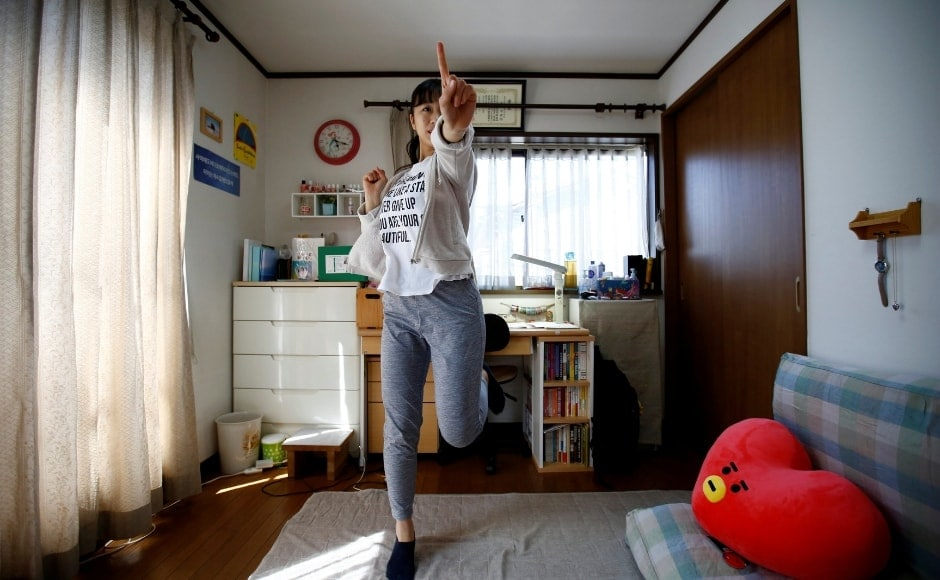 Nao Niitsu, 19, a college freshman from Tokyo, who wants to be a K-pop star, practices dancing to K-pop songs in her room in Tokyo, Japan. Reuters/Kim Kyung-Hoon.
