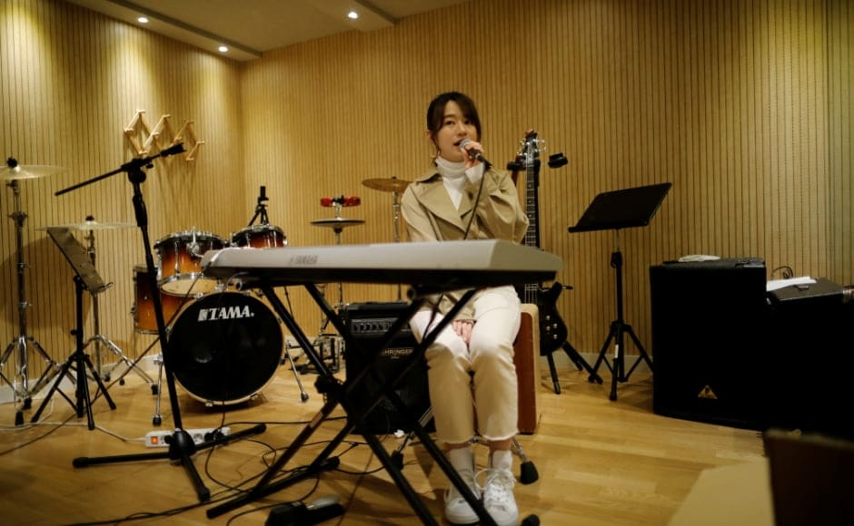 Miyu Takeuchi, a trainee with the K-pop agency Mystic Entertainment, sings during a training session in Seoul. Takeuchi said it wasn't a difficult decision to leave a 10-year career with a top idol band <em>AKB48</em> back home in Japan to sign with the K-pop agency Mystic Entertainment in March as a trainee. Even with her experience, she has seven hours of vocal training a day and two-hour dance lessons twice a week, plus early morning Korean lessons. She is not allowed to have a boyfriend but she says she has no regrets, despite the fact there is no guarantee she will make it. Reuters/Kim Hong-Ji.