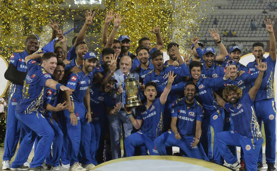 The victorious Mumbai Indians team pose with the IPL trophy. AFP