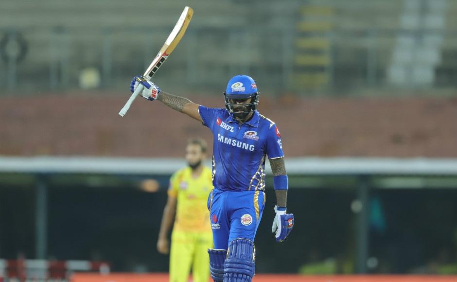 Suryakumar Yadav raises his bat in acknowledgement after bringing up his half-century. Sportzpics