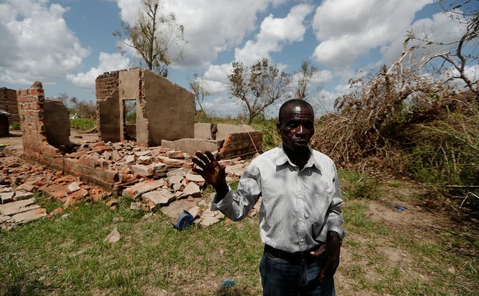 Joao stands in front of his damaged house as he reflects on how they haven't seen anyone from the government since the disaster struck. Reuters/Zohra Bensemra.
