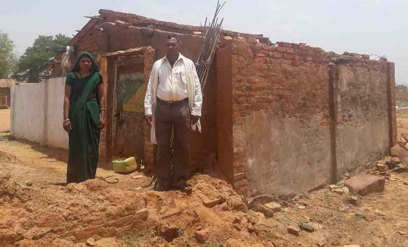 Sasikala and her husband, outside their home in Saradah, Uttar Pradesh, which was destroyed by a storm. Parth MN