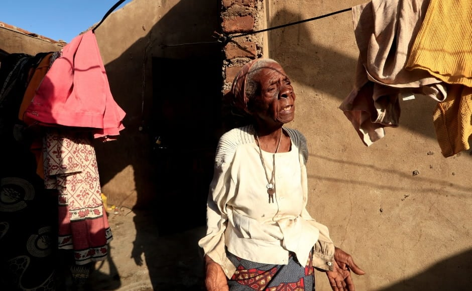 Another survivor from Cheia, Tchacaca Quembo, stands outside her damaged house. In 2000, Quembo's home in the community of Quanuno was wrecked by severe floods. In March 2019, Cyclone Idai hit her new home. She explains that the wind ripped the roof off her house, and she survived by standing inside her bedroom, in the water from Friday to Sunday. Reuters/Zohra Bensemra.