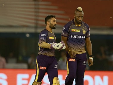 Captain of KKR Dinesh Karthik and Andre Russell during their match against Kings XI Punjab. Sportzpics