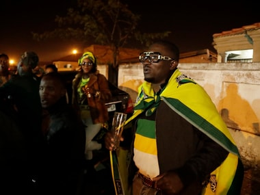 Supporters of African National Congress (ANC) celebrate their party election victory. AP