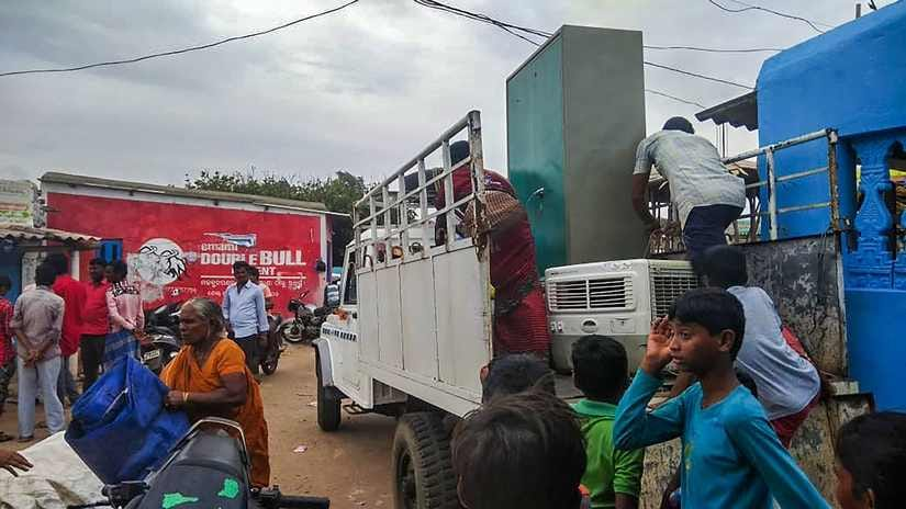 Villagers living in vulnerable low-lying areas being shifted to cyclone shelter house, in Puri. PTI