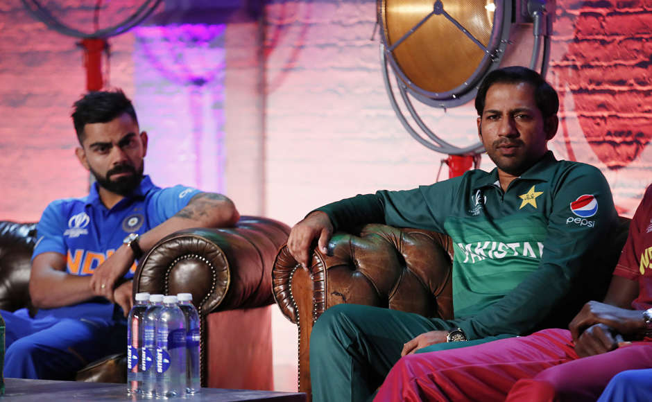 Virat Kohli is pictured with Pakistan captain Sarfaraz Ahmed. The much-awaited India-Pakistan match will take place on 16 June. AFP
