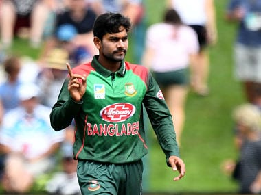 Bangladesh's Mehidy Hasan Miraz celebrates the wicket of New Zealand's Henry Nicholls during the third one-day international cricket match between New Zealand and Bangladesh at University Oval in Dunedin on February 20, 2019. (Photo by Marty MELVILLE / AFP)