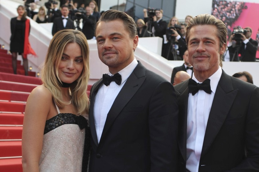 Actors Margot Robbie from left, Leonardo DiCaprio and Brad Pitt poses for photographers upon arrival at the premiere of the film 'Once Upon a Time in Hollywood' at the 72nd international film festival, Cannes, southern France, Tuesday, May 21, 2019. (AP Photo/Petros Giannakouris)