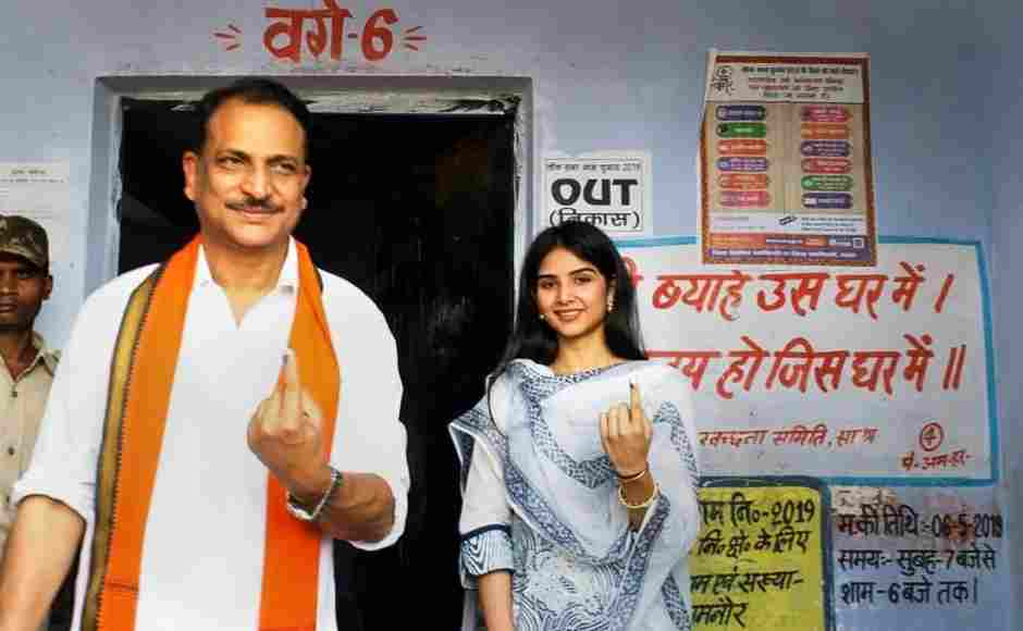BJP candidate from Saran, Rajiv Pratap Rudy, with his daughter Atisha Pratap showed their inked fingers after casting vote at a polling station in Chhapra. PTI