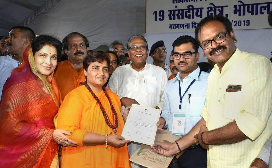 BJP candidate Sadhvi Pragya Singh Thakur collected her victory certificate after declaration of result for Lok Sabha elections at old Central Jail, in Bhopal. Reuters