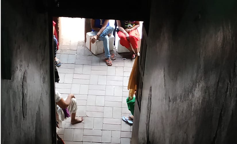 Sex workers sitting on a pavement on GB Road. Debobrat Ghose/Firstpost