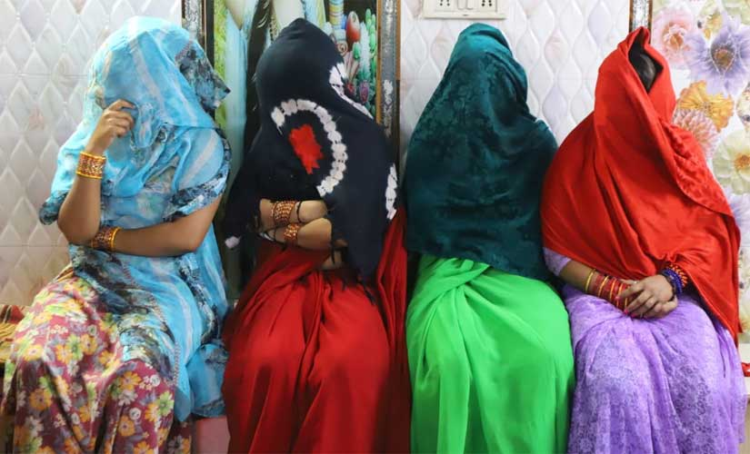 Sex workers with their faces covered in the GB Road area of Chandni Chowk Lok Sabha constituency. Debobrat Ghose/Firstpost