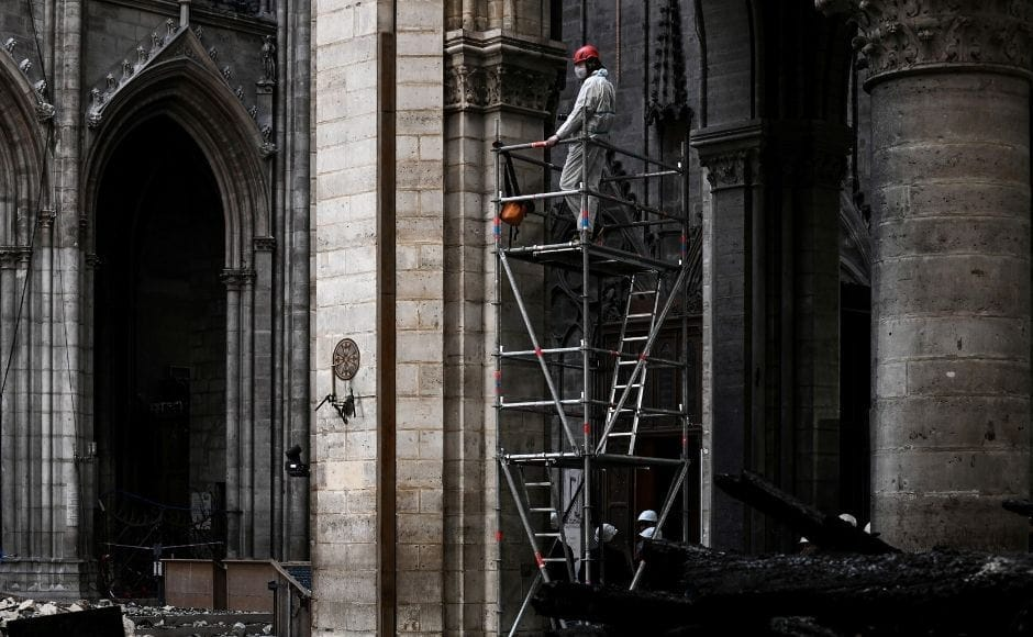 A national and cultural symbol, the 13th-century Gothic cathedral's burning resulted in national mourning. French President Emmanuel Macron called for unity and declared that the cathedral would be restored in five years, which many experts consider an impossible timeline. Reuters via Pool/Philippe Lopez.