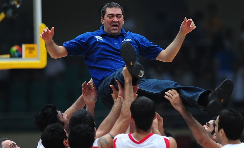 Veselin Matic is tossed in the air by jubilant Iran players following victory over China in the final of the Asian Basketball Championships in 2009. AFP