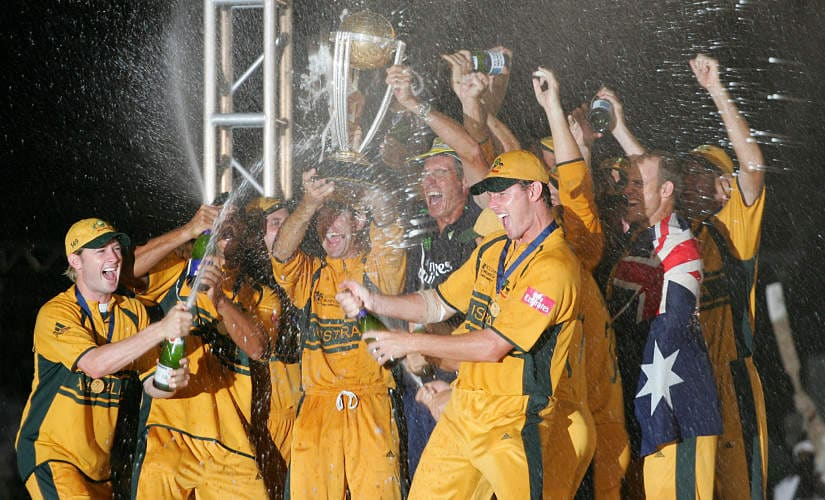 The Australian cricket team led by captain Ricky Ponting hold the ICC Cricket World Cup Trophy as they celebrate beating Sri Lanka in the final of the ICC Cricket World Cup 2007, at the Kensington Oval stadium in Bridgetown, in Barbados, 28 April 2007. Australia beat Sri Lanka by 53 runs here on Saturday to win the World Cup for the third successive time and fourth overall. AFP PHOTO/ADRIAN DENNIS (Photo by ADRIAN DENNIS / AFP)
