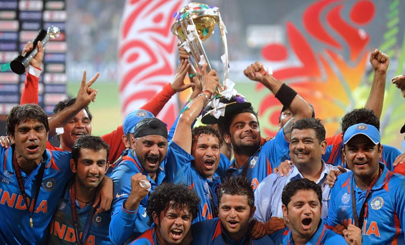 Indian cricketers pose with the trophy as they celebrate after beating Sri Lanka in the ICC Cricket World Cup 2011 final match at The Wankhede Stadium in Mumbai on April 2, 2011. India defeated Sri Lanka by six wickets on Saturday to win the 2011 World Cup. AFP PHOTO/MANAN VATSYAYANA (Photo by MANAN VATSYAYANA / AFP)