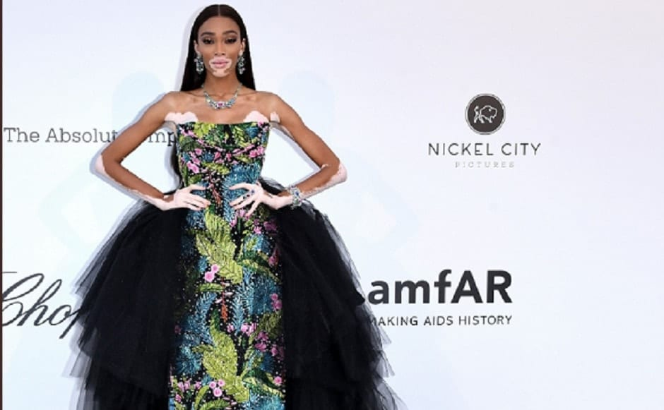 Model Winnie Harlow wore a Richard Quinn embroidered gown, along with tulle overskirt for the gala | Twitter