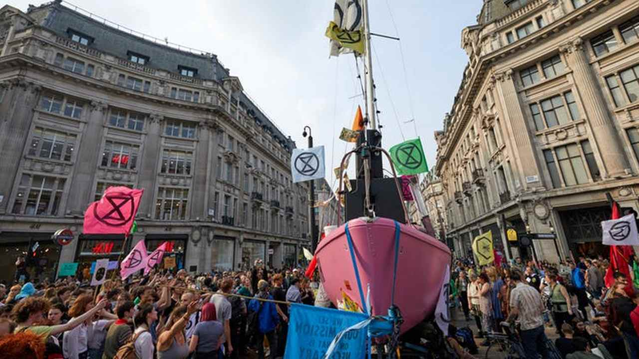 Extinction Rebellion protesters surround a boat blocking Oxford Circus, London. image credit: Kevin J. Frost/Shutterstoc