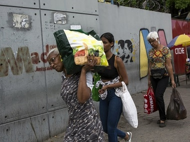 Venezuela unrest: Daily life resumes after two days of violent clashes as locals continue struggle amid 'deepest' economic crisis