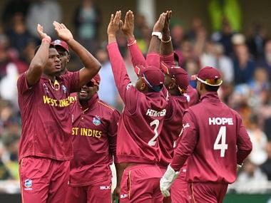 West Indies' Oshane Thomas celebrates after taking the wicket of Pakistan's Shadab Khan. AFP