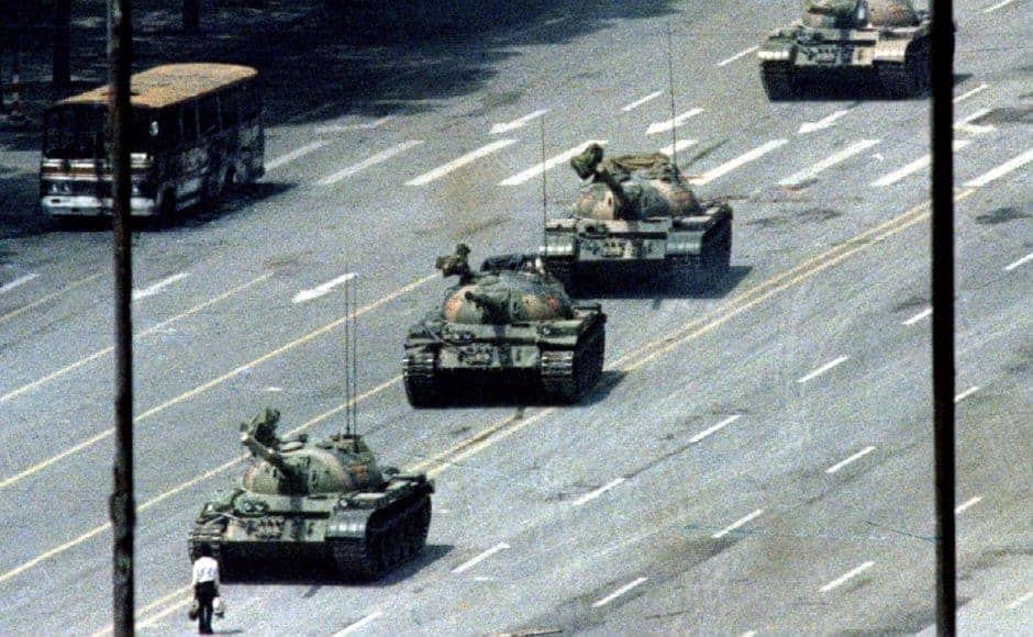 A Beijing citizen stands in front of a convoy of tanks on the Avenue of Eternal peace in Tiananmen Square in 1989. Today, thirty years after the massacre, strict censorship restricts any mention or commemoration of the protests in China, and the incident is absent from history books. Reuters/Stringer.