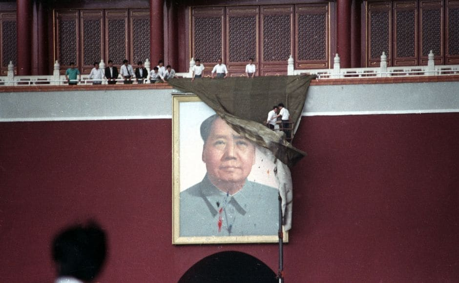 Workmen try to drape the portrait of Mao Zedong, in Tiananmen Square, 23 May, 1989. He was a founder father of the People's Republic of China and Chairman of China's Communist Party from its inception in 1949 to his death in 1976. Reuters/Ed Nachtrieb.