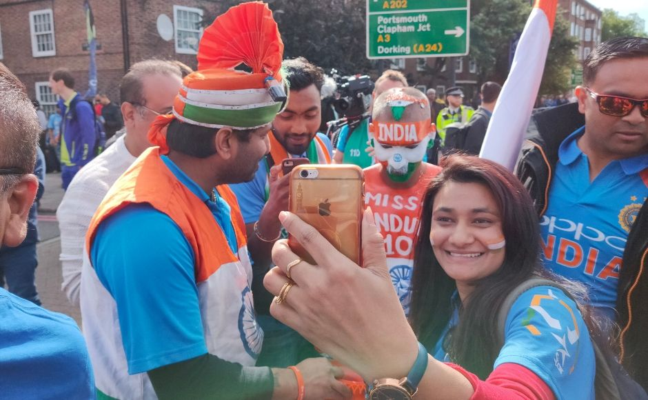 Fans clicking selfies with Sudhir Gautam, a Sachin Tendulkar superfan who travels around the world to support the Indian cricket team. Image clicked via OPPO Reno 10X Hybrid zoom