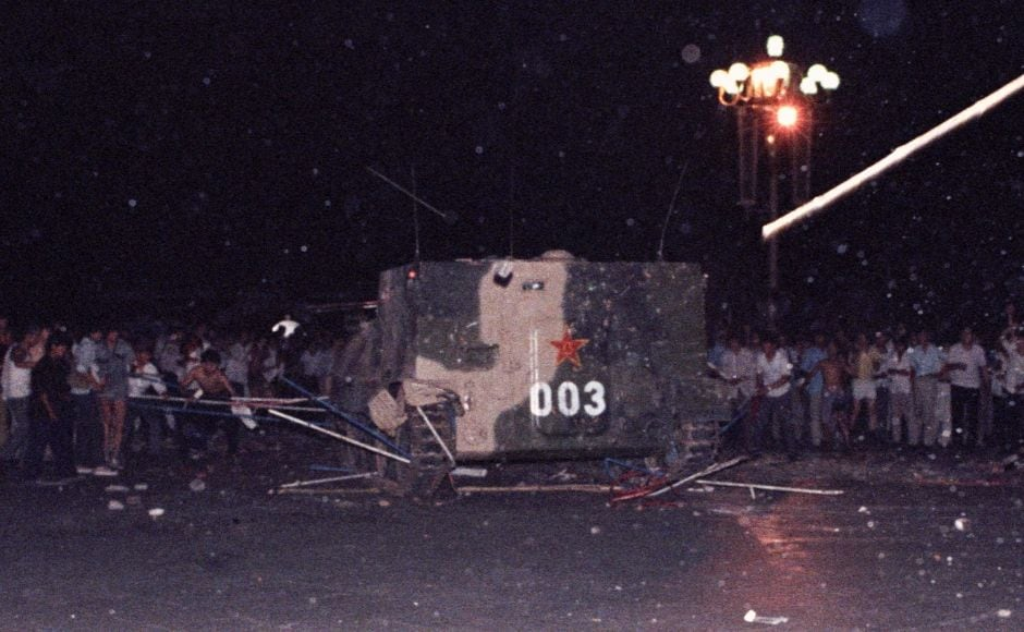 An armored military vehicle crushes one of the tents set up on Tiananmen Square by pro-democracy protesters. Today, protesters maintain a decided silence, not telling their children about their role in the protests. They worry about how it might influence their children and acknowledge that any remembrance of the protests is dangerous in modern-day China. Reuters/Stringer.