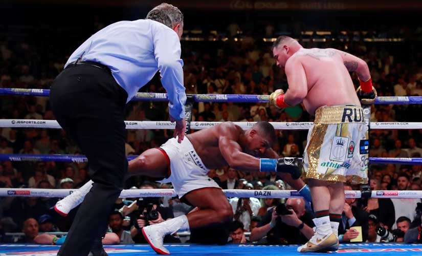 Underdog Andy Ruiz Jr. beats Anthony Joshua in shock victory at Madison Square Garden to become three-belt heavyweight champion